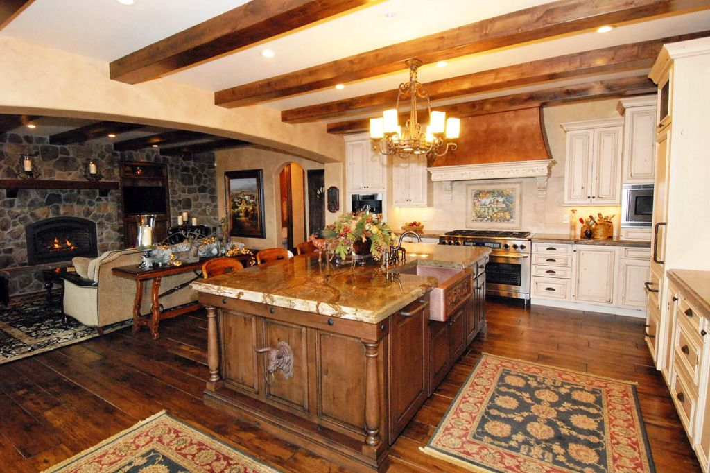Country Kitchen with L-shaped, Standard height, Exposed beam, Limestone, wall oven, full backsplash, Flush, Breakfast bar