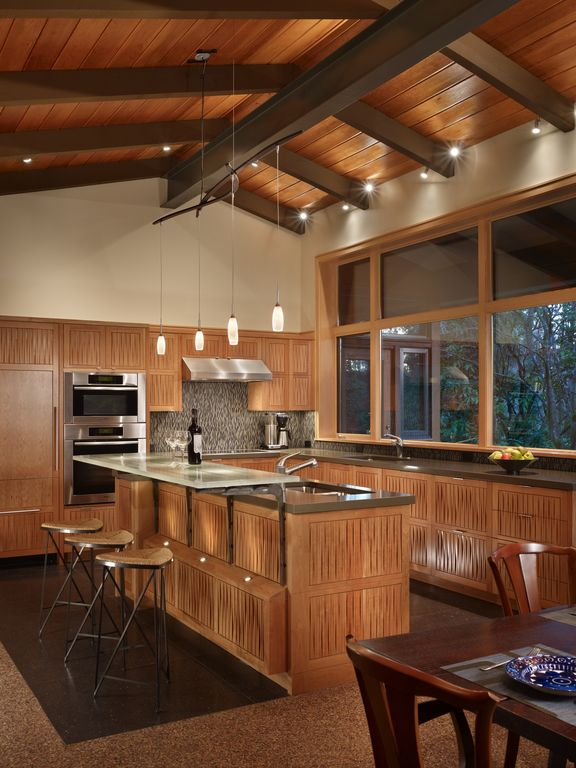 Contemporary Kitchen with Concrete counters, L-shaped, Exposed beam, Kitchen island, Pendant lights, Breakfast bar, Flush