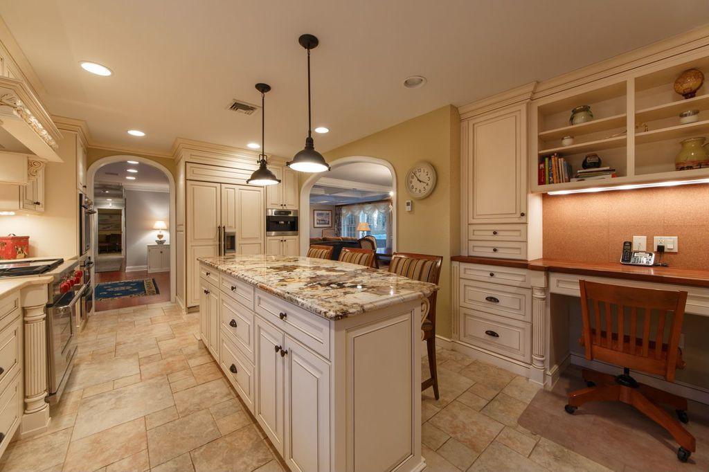 Country Kitchen with Standard height, stone tile floors, U-shaped, can lights, Raised panel, Simple Granite Tile, Custom hood