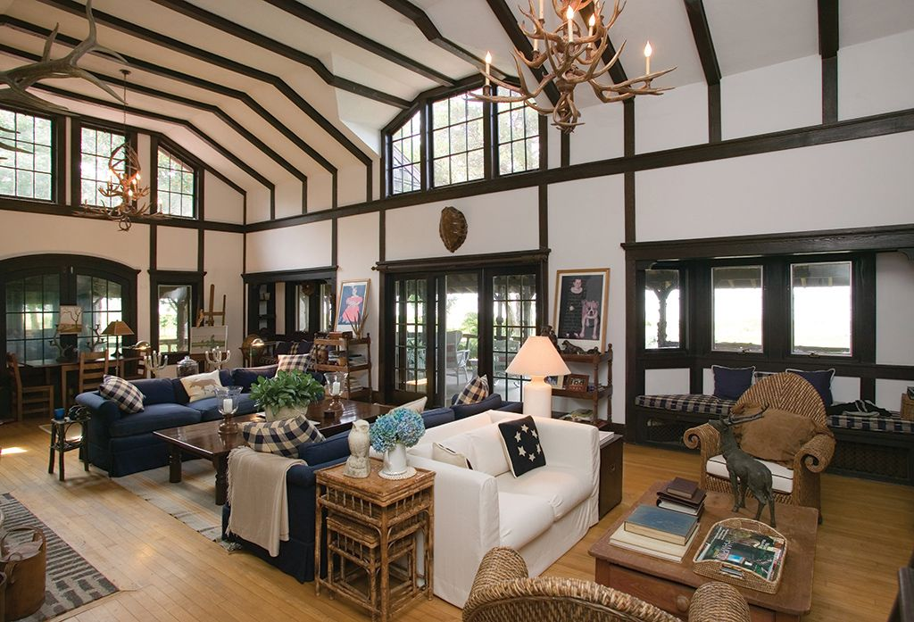 Country Great Room with Casement, High ceiling, Hardwood floors, Crown molding, Window seat, sliding glass door, Exposed beam