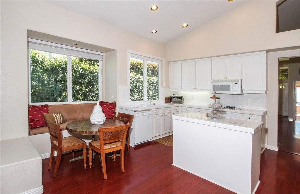 Traditional Kitchen with Laminate floors, Paint 1, Undermount sink, Breakfast nook, wall oven, can lights, Large Ceramic Tile