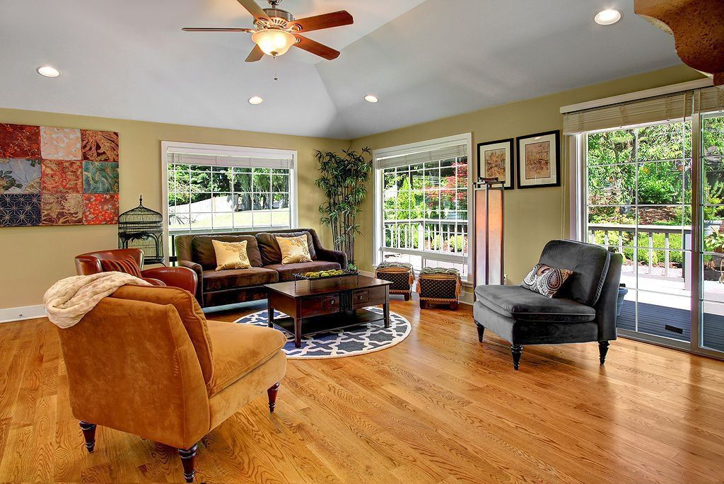 Traditional Living Room with picture window, can lights, Paint, Ceiling fan, Casement, sliding glass door, Standard height