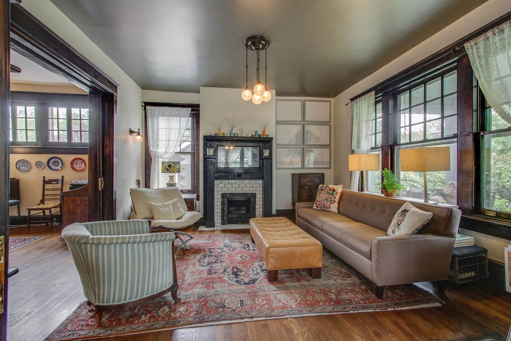 Eclectic Living Room with Hardwood floors, Pendant Light, High ceiling, Carpet