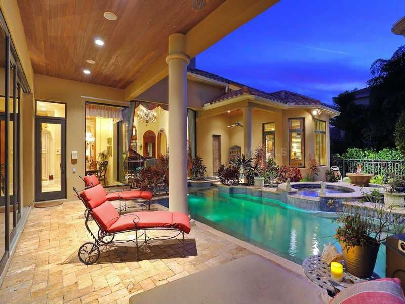 Mediterranean Swimming Pool with picture window, Casement, Pool with hot tub, exterior stone floors, Fence, French doors
