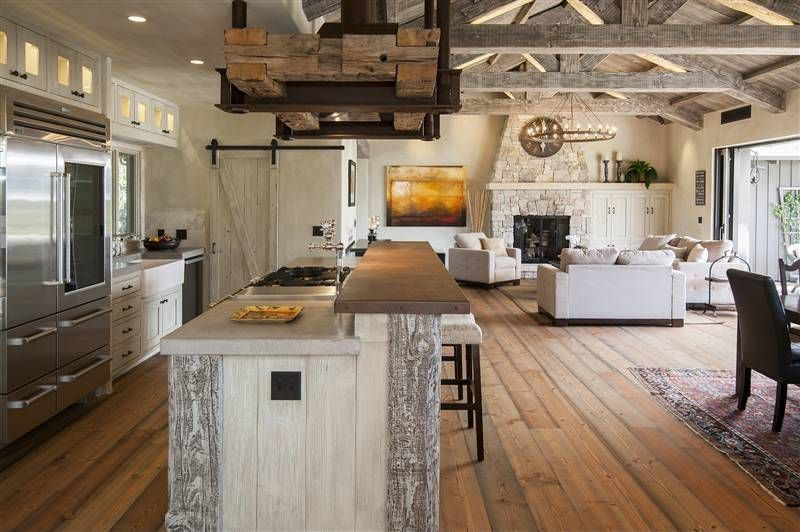 Rustic Kitchen with Kitchen island, Flat panel cabinets, electric cooktop, Standard height, Paint 1, limestone tile floors