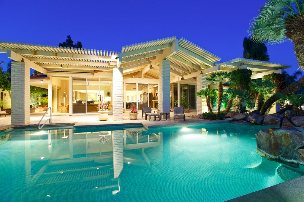 Contemporary Swimming Pool with Other Pool Type, Trellis, Pathway, exterior stone floors, sliding glass door, picture window