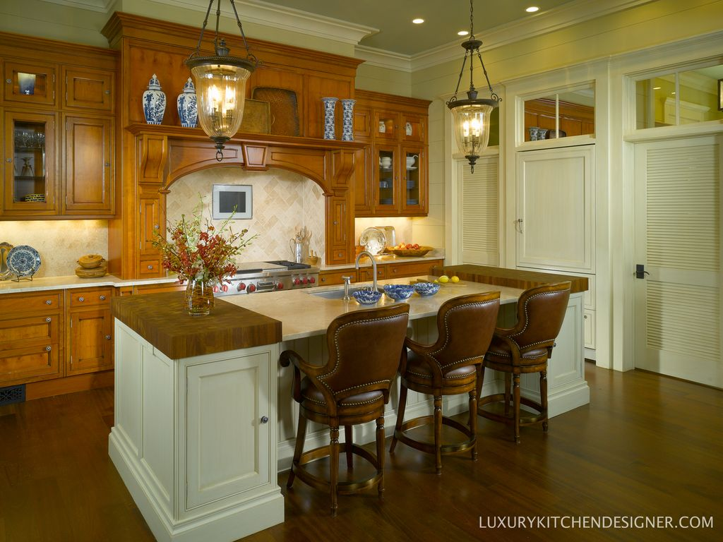 Traditional Kitchen with Standard height, Wood counter slab, Flat panel cabinets, Kitchen island, Undermount sink, can lights
