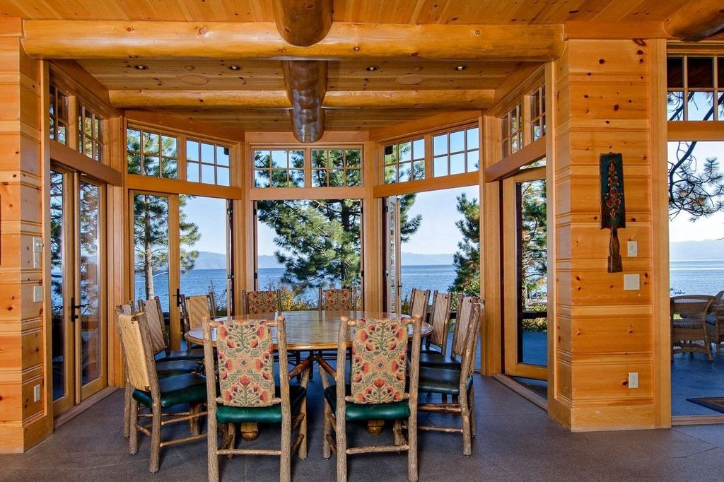 Rustic Dining Room with Transom window, simple granite floors, French doors, Exposed beam, Standard height, can lights