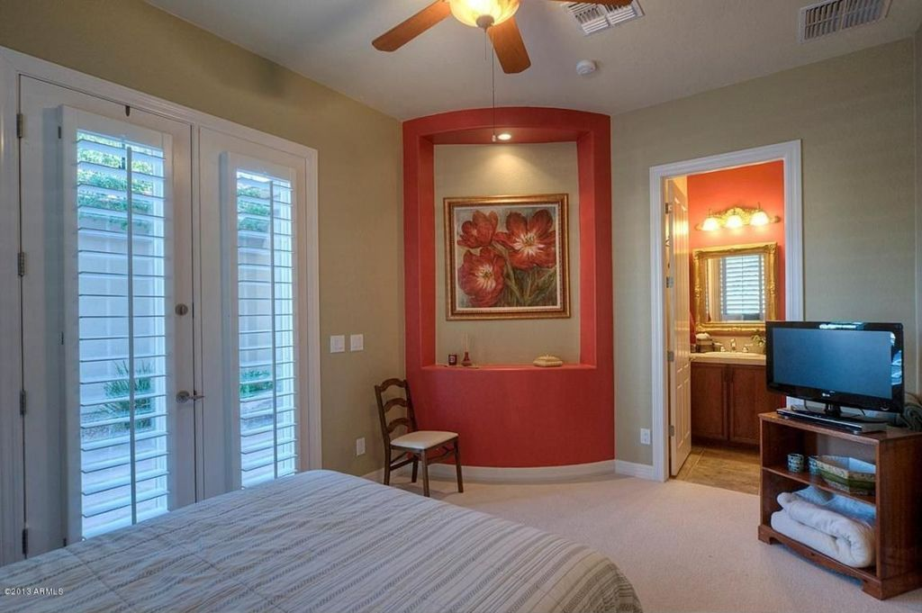 Traditional Guest Bedroom with Carpet, French doors, can lights, Built-in bookshelf, Standard height, Ceiling fan