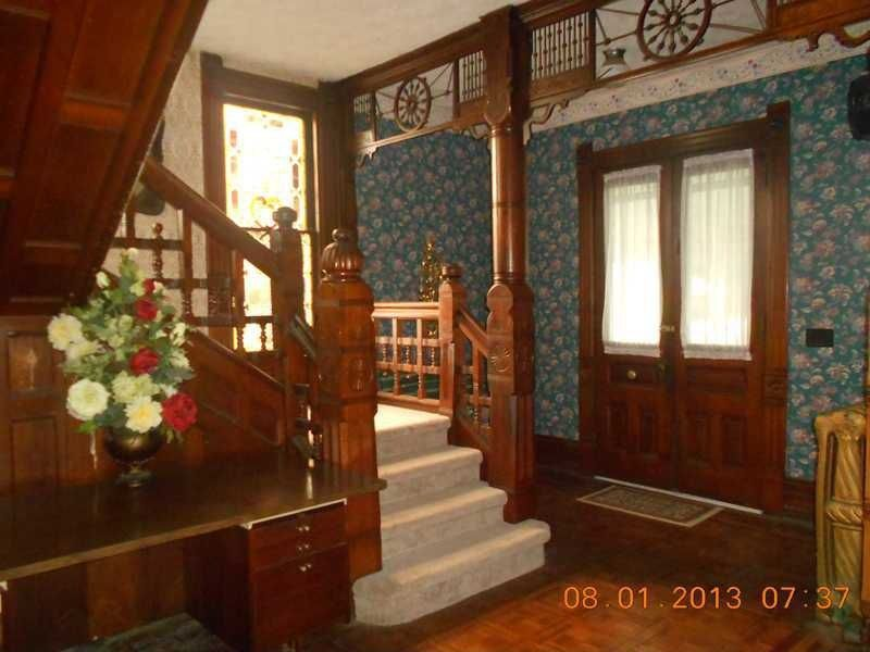 Craftsman Staircase with Standard height, double-hung window, curved staircase, interior wallpaper, Carpet