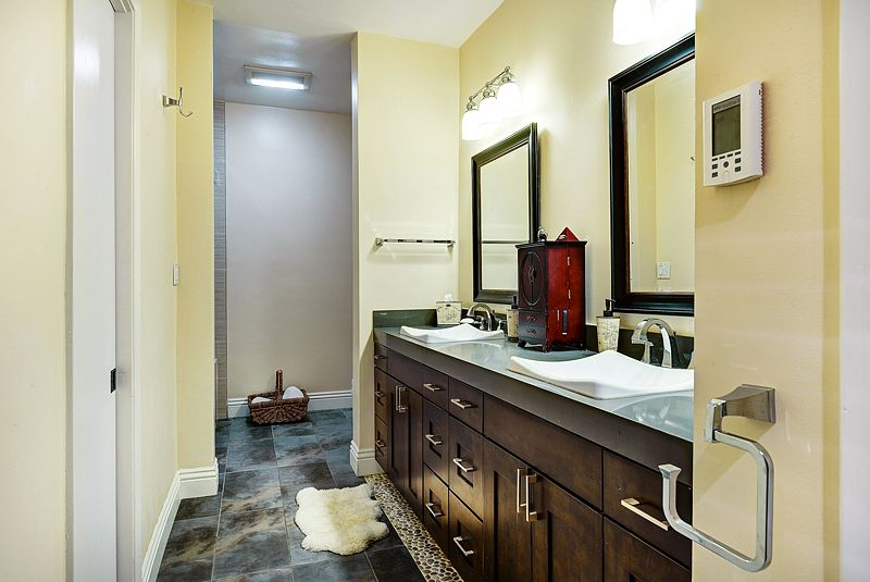 Contemporary Master Bathroom with partial backsplash, Standard height, Flat panel cabinets, Vessel sink, stone tile floors