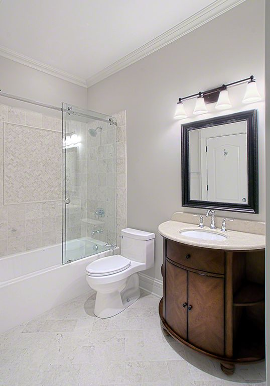 Traditional Full Bathroom with stone tile floors, Inset cabinets, Undermount sink, wall-mounted above mirror bathroom light