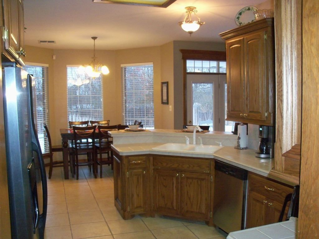 Traditional Kitchen with Limestone, French doors, Breakfast nook, U-shaped, Inset cabinets, limestone tile floors