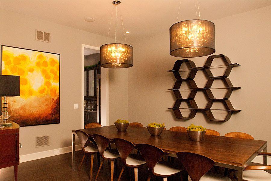 Contemporary Dining Room with Standard height, Hardwood floors, Built-in bookshelf, Pendant light, can lights