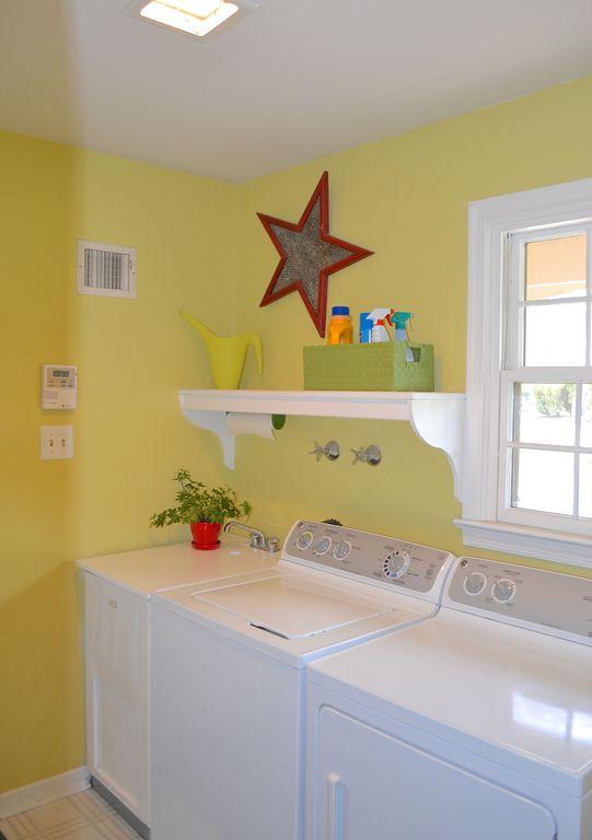 Traditional Laundry Room with Carpet, flush light, Built-in bookshelf