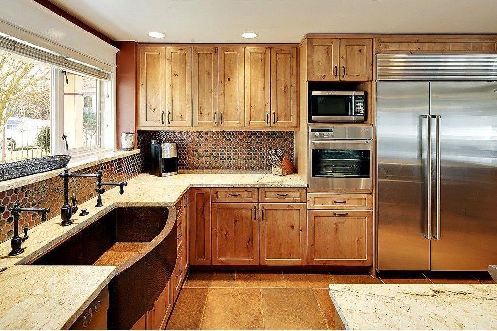 Craftsman Kitchen with Standard height, Built In Refrigerator, can lights, Flush, Penny Tile, full backsplash, Kitchen island