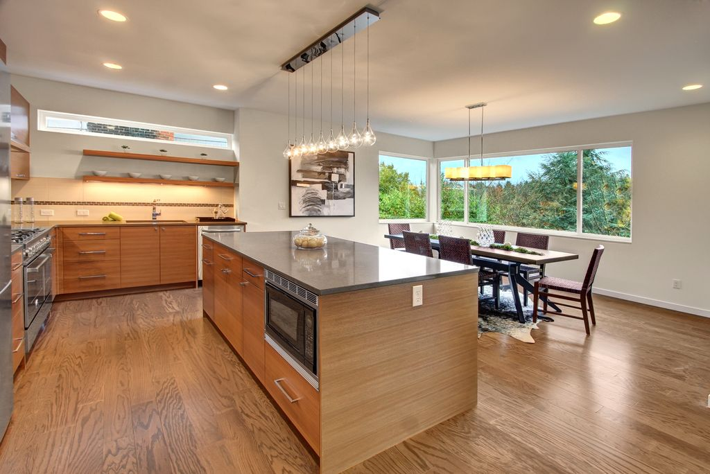 Modern Kitchen with Paint 1, Ceramic Tile, flush light, Pendant light, Soapstone counters, built-in microwave, L-shaped
