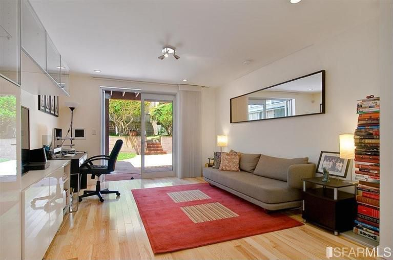 Contemporary Home Office with French doors, can lights, flush light, Hardwood floors, Standard height, Built-in bookshelf
