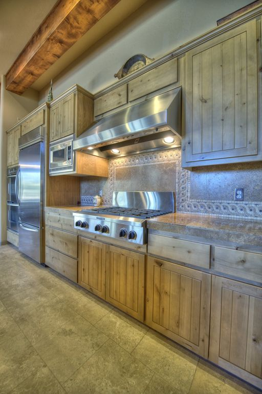 Eclectic Kitchen with Standard height, Flush, electric cooktop, Simple Granite, One-wall, double wall oven, Exposed beam