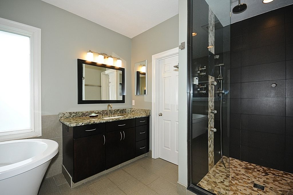 Contemporary Full Bathroom with frameless showerdoor, wall-mounted above mirror bathroom light, Standard height, Freestanding