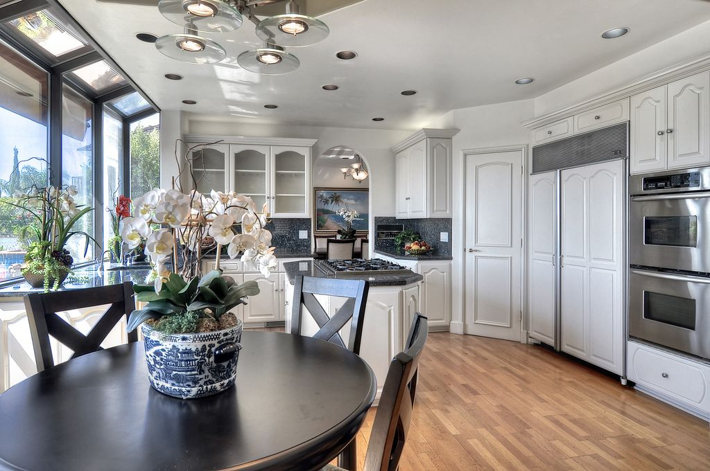 Traditional Kitchen with double wall oven, electric cooktop, Multiple Sinks, Breakfast nook, specialty door, Simple Granite