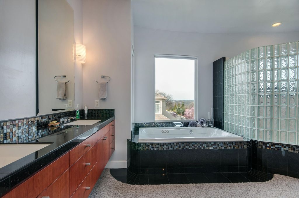 Contemporary Master Bathroom with Standard height, Flush, can lights, Wall sconce, stone tile counters, Bathtub, Double sink