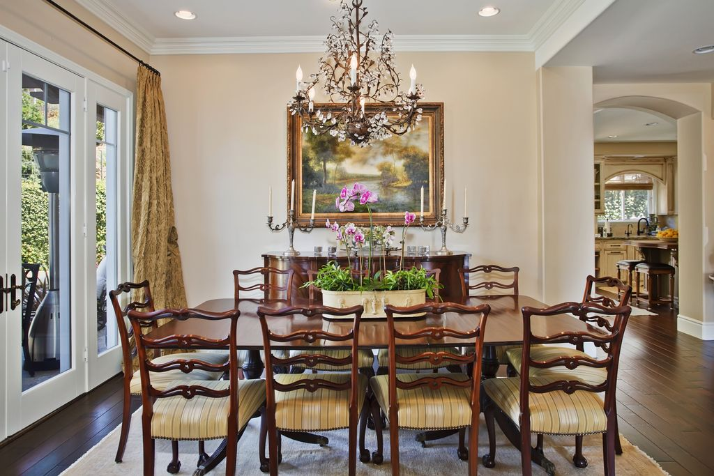 Traditional Dining Room with Wildon home penderbrook sideboard, Standard height, Paint 1, Hardwood floors, French doors