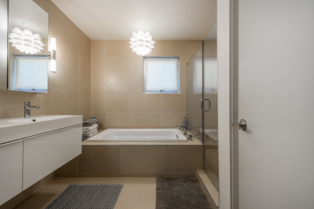Contemporary Master Bathroom with frameless showerdoor, partial backsplash, Undermount sink, Standard height, Wall sconce