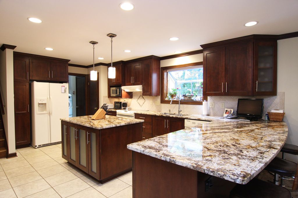 Traditional Kitchen with built-in microwave, Glass panel, dishwasher, travertine tile floors, Built In Refrigerator, Flush