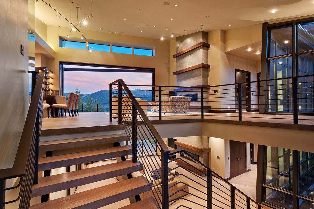 Contemporary Staircase with curved staircase, High ceiling, Hardwood floors