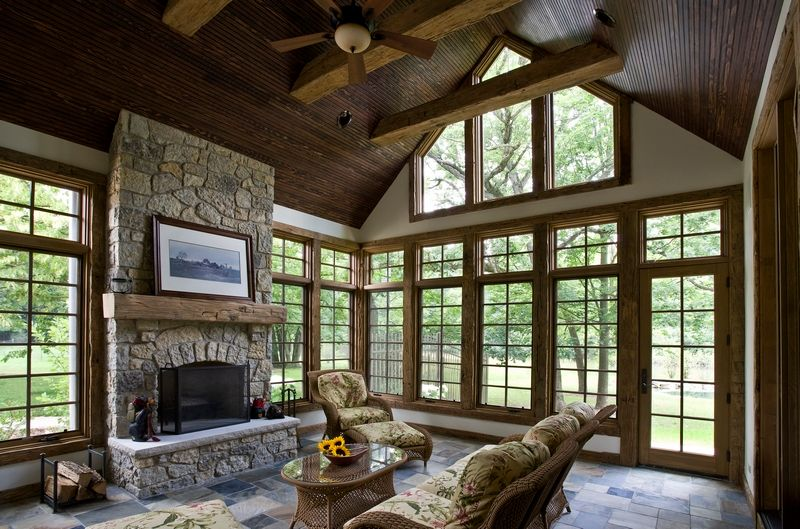Rustic Living Room with Black Bear Manufactured Fieldstone-Midnight, Fireplace, Exposed wood ceiling, Concrete tile