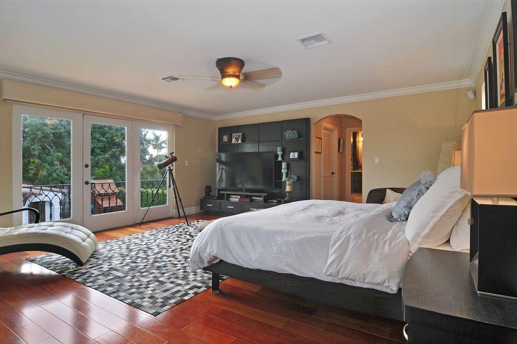 Contemporary Master Bedroom with Built-in bookshelf, French doors, Crown molding, Hardwood floors, Standard height