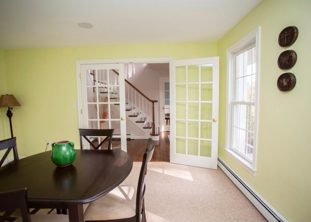 Traditional Dining Room with Standard height, Carpet, double-hung window, French doors
