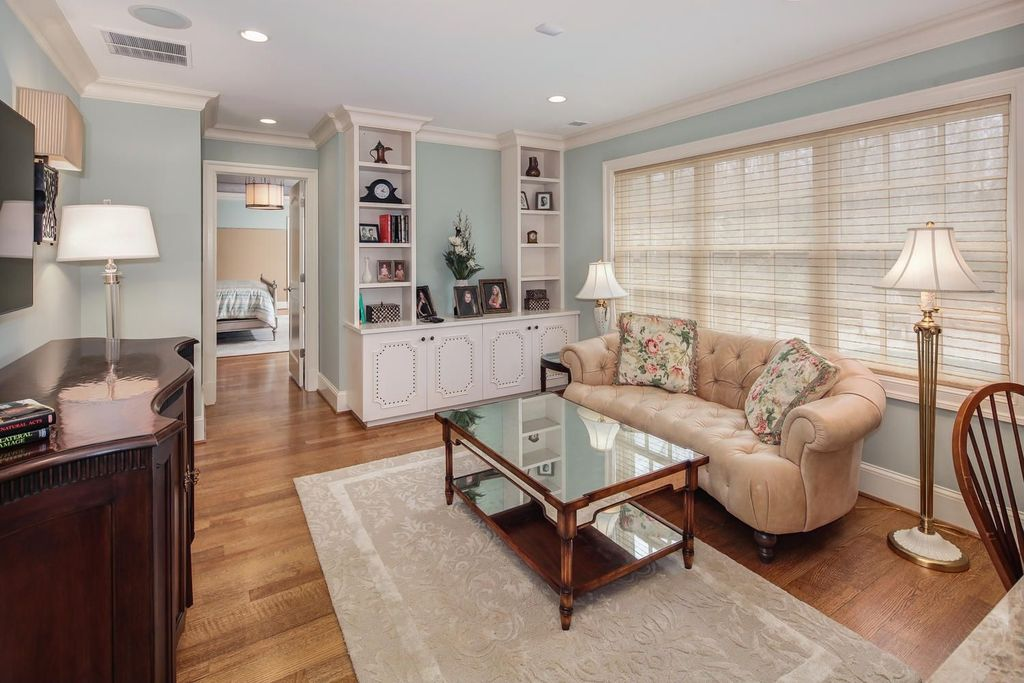 Traditional Living Room with Built-in bookshelf, Hardwood floors, Crown molding