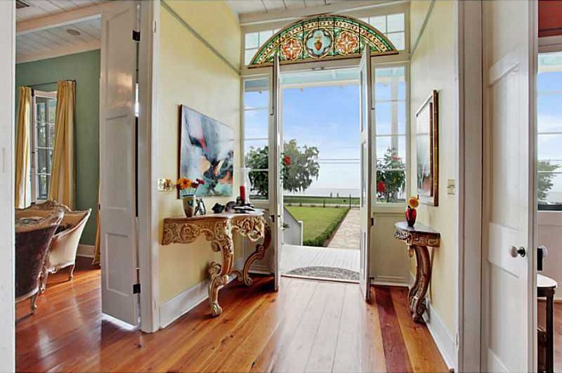 Traditional Entryway with French doors, Standard height, Transom window, Hardwood floors, picture window