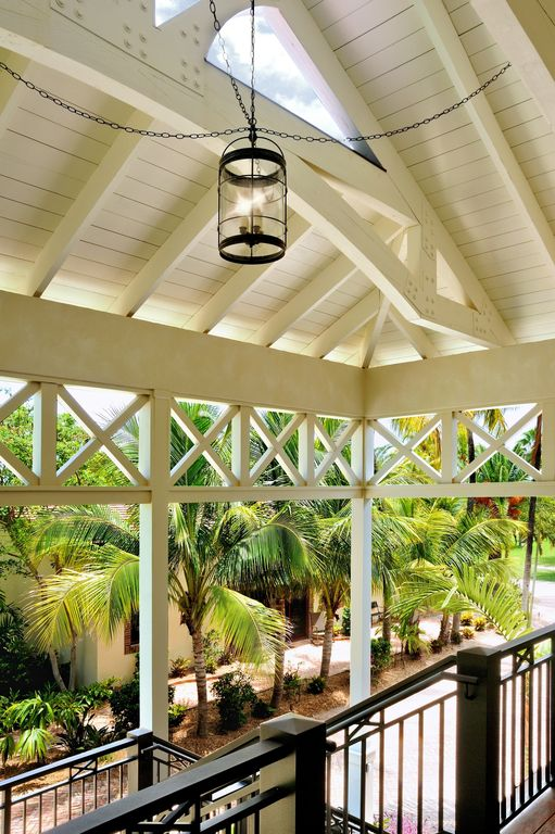 Tropical Porch with Screened porch, Deck Railing, exterior stone floors, Fence