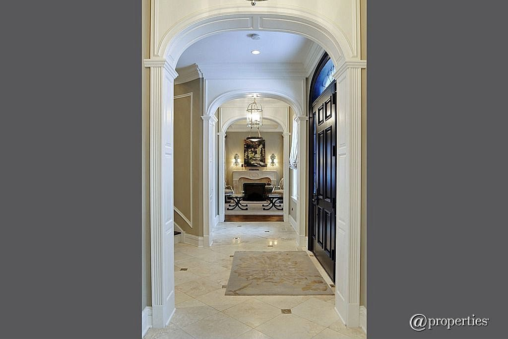 Traditional Hallway with flush light, simple marble tile floors, Transom window, Crown molding