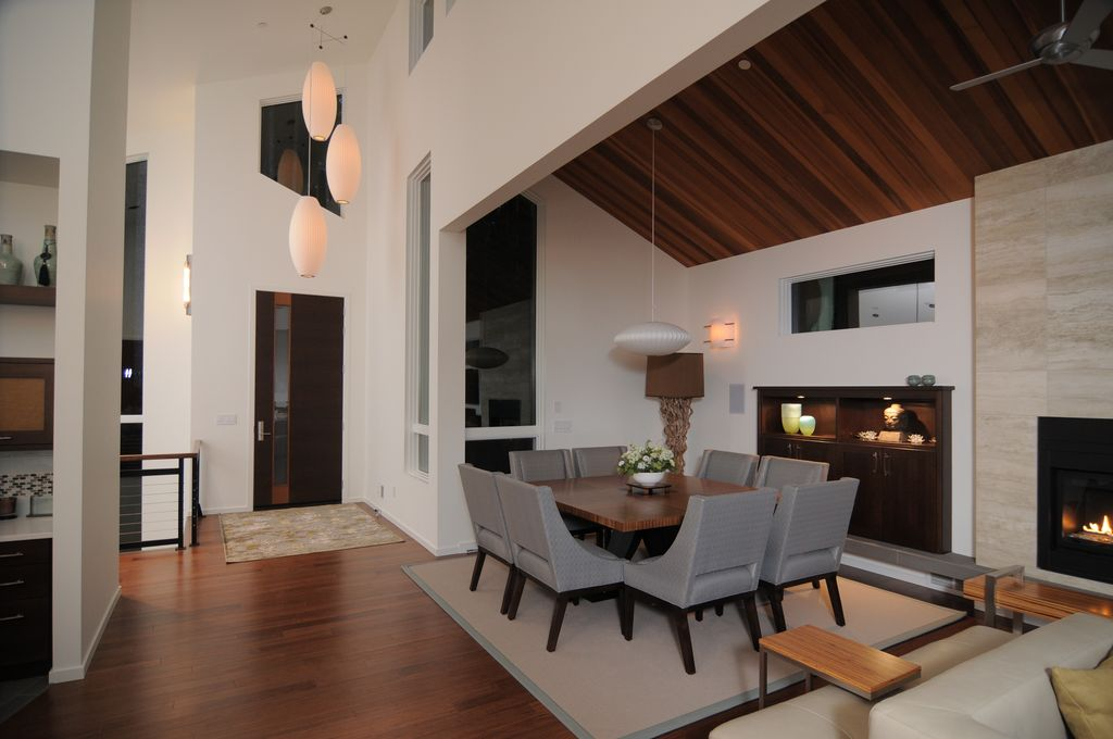 Contemporary Dining Room with insert fireplace, Hardwood floors, flush light, Fireplace, picture window, Exposed beam