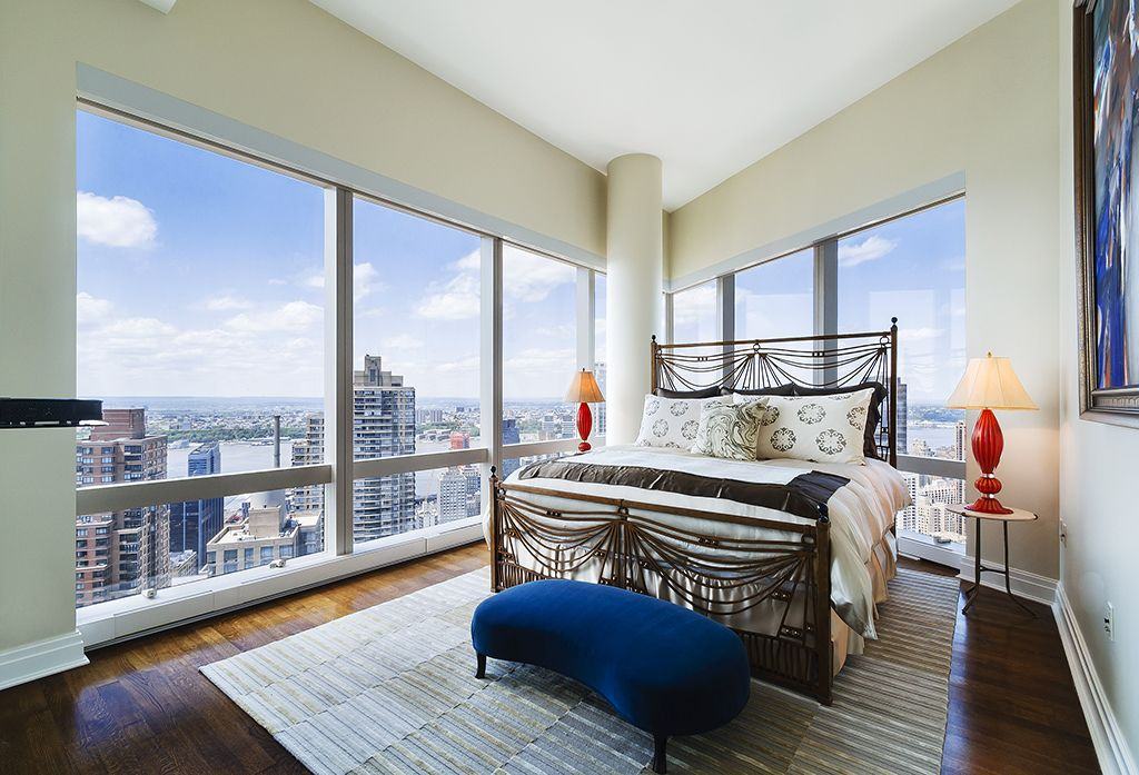 Contemporary Master Bedroom with Standard height, picture window, Columns, Hardwood floors