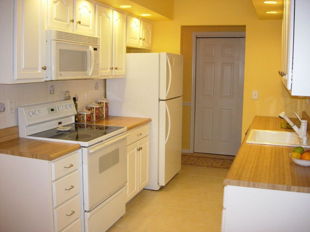 Traditional Kitchen with built-in microwave, stone tile floors, limestone tile floors, Inset cabinets, double oven range