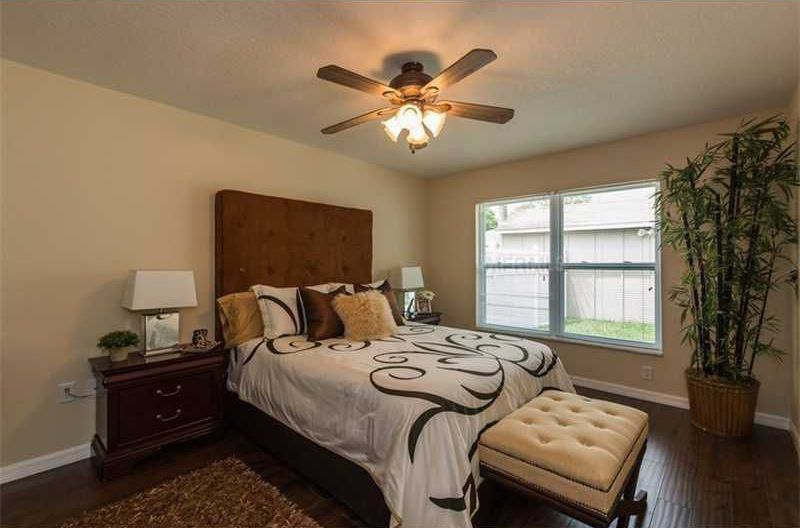 Traditional Master Bedroom with double-hung window, Hardwood floors, Ceiling fan, Standard height