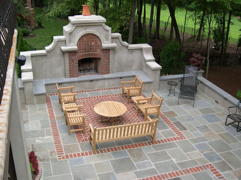 Traditional Patio with Fence, exterior stone floors, Deck Railing