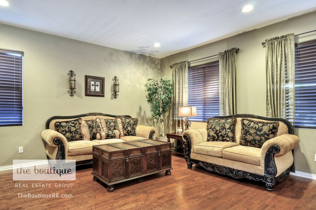 Traditional Living Room with Wall sconce, Hardwood floors, Standard height, can lights