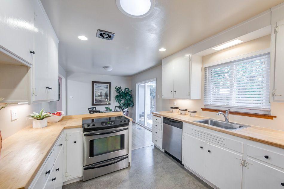 Contemporary Kitchen with Wood counters, Breakfast nook, Brooks Custom Edge Grain Wood Countertops, U-shaped, flush light