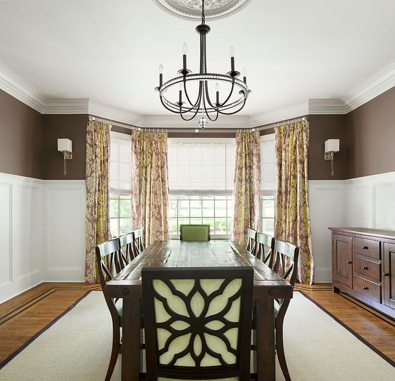 Traditional Dining Room with Wall sconce, Hardwood floors, Wainscotting, Bay window, Crown molding, Standard height, Paint 2