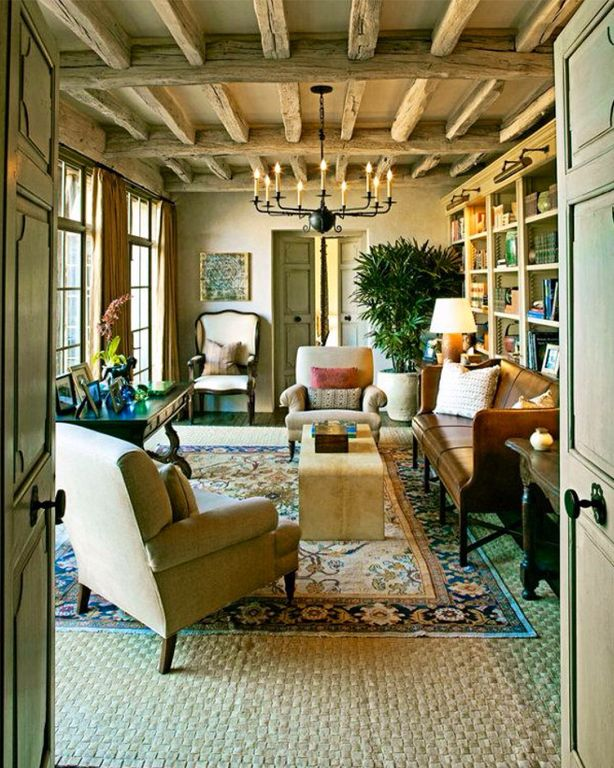 Rustic Living Room with bedroom reading light, Exposed beam, can lights, Zoey armchair with ottoman, Chandelier, Carpet