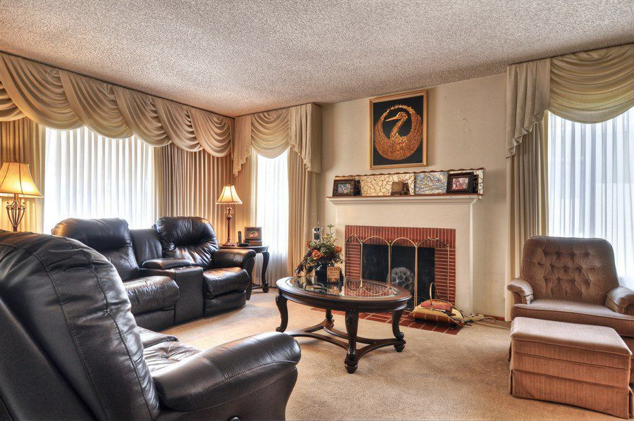 Traditional Living Room with Fireplace, Carpet, Standard height, metal fireplace