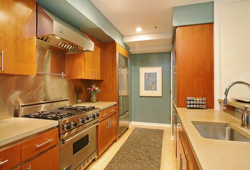 Modern Kitchen with Undermount sink, European Cabinets, Silestone-Quartz Countertop in Daria, Destiny: slab cabinets, Galley