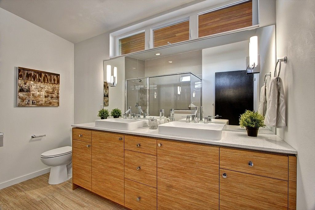 Contemporary Master Bathroom with Flush, Vessel sink, Simple granite counters, European Cabinets, Double sink