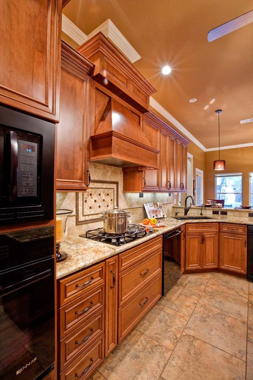 Traditional Kitchen with Custom hood, Pendant light, two dishwashers, Flush, MSI Granite Countertops in Golden Riviera